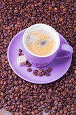 A cup of coffee with coffee beans — Stock Photo