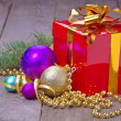 Gift box with christmas balls, fir and beads — Stock Photo