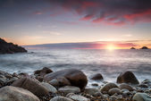 Sunset at Porth Nanven Cove in cornwall — Stock Photo