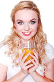 Happy beautiful woman holding glasses with fresh orange juice  — Zdjęcie stockowe