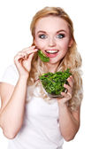 Portrait of young beautiful woman eating green fresh salad  — Stockfoto