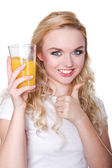 Happy beautiful woman holding glasses with fresh orange juice  — Stock Photo