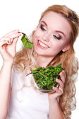 Portrait of young beautiful woman eating green fresh salad  — Stock Photo