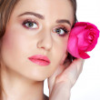 Close-up portrait of young girl woman with pink rose — Stock Photo #43931083