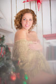 Portrait of smiling plus size young woman near christmas tree wr — Stock Photo