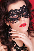 Beautiful Woman with Black Lace mask over her Eyes. Red Sexy Lip — Stockfoto