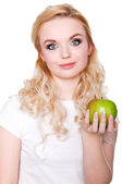 Woman with green apple — Stockfoto