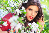 Model with cherry flowers — Stock Photo