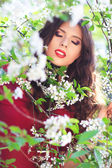 Woman with cherry flowers — Stock Photo