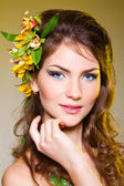 Woman with flowers in hair — Stock Photo