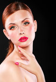 Attractive girl with red lips and nails — Stock Photo