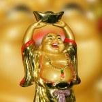Figurine Cheerful Hotei — Stock Photo #32529611