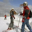 Skiers on ski resort - Stock Photo