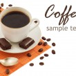 Close-up of white cup of coffee and chocolate (easy removable text) — Stock Photo