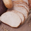 Composition of bread and wheat spikelets — Stock Photo