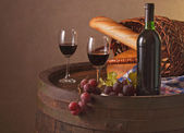 Still life with wine barrel, bread and cheese — Stock Photo