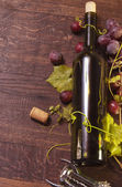 A bottle of wine on a barrel as background — Stock Photo