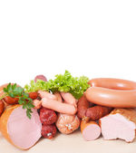 Meat and sausage . Isolated on a white background , with clipping path included — Stock Photo
