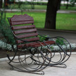 Metal forged bench in summer park — Stock Photo