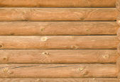 Background texture of the new light-brown wooden logs — Stock Photo