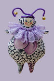 Hand made soft toy doll isolated on purple background — Stock Photo