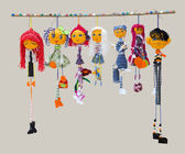Six female and one male handmade isolated thin dolls toys in fas — Stock Photo