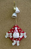 Handmade New Year talisman obereg with snowman and bells — Stock Photo