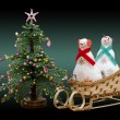 Handmade soft toy two snowmans on a sled and New Year tree — Stock Photo