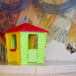 Isolated plastic children's playhouse on beautifully designed st — Stock Photo #36916371