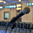 Stock Photo: Microphone at front close-up in hall richly