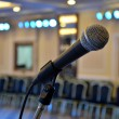 Microphone at the front close-up in the hall richly — Stock Photo