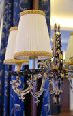 Electric lamp in a luxurious vintage style on the mirror — Stok fotoğraf