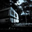 Vintage camper van at the night — Stock Photo #35490461