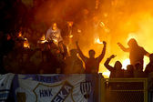 Soccer fans with alight the torches at the stadium — Stock Photo