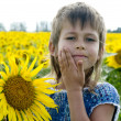 Stock Photo: Girl with sunflower