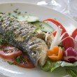 Seabass with vegetables — Stock Photo