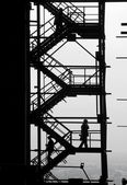Silhouettes of at the industrial project — Stock Photo