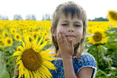 Girl with sunflower — Stock Photo