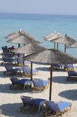Sun loungers on the beach — Stock Photo