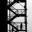 Stock Photo: Silhouettes at industrial project