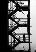 Silhouettes at the industrial project — Stock Photo