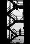 Workpeople silhouettes at the industrial project — Stock Photo
