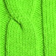 Knitted green plait — Stock Photo
