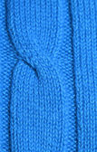 Knitted blue plait — Stock Photo