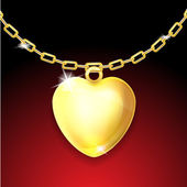 Golden necklace with glossy heart — Stock Photo
