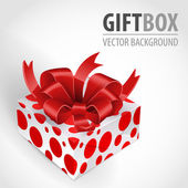 Gift box with bow and red spots. — Stock Vector