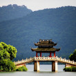 A pavilion bridge in west lake, hangzhou, china — Stock Photo #21023159