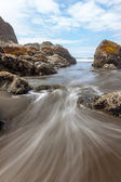 Incoming waterflow at Ruby Beach — Stock Photo
