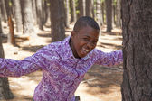 Young boy smiling in the woods — Stock Photo