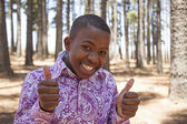 Young african boy looking to the camera and smiling — Stock Photo